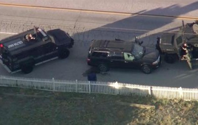 Armored vehicles surround an SUV following a shootout in San Bernardino, Calif., Wednesday, Dec. 2, 2015. The scene followed a military-style attack that killed multiple people and wounded others at a California center that serves people with developmental disabilities, authorities said.   (KTTV via AP)