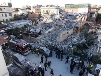 A view of the two-story building collapsed in Acilia today, Wednesday, on the southern outskirts of Rome, probably because of a gas leak. Two people, a man and a woman, were pulled alive from the rubble. Rome, Italy, Dec. 28, 2016. ANSA/ MASSIMO PERCOSSI